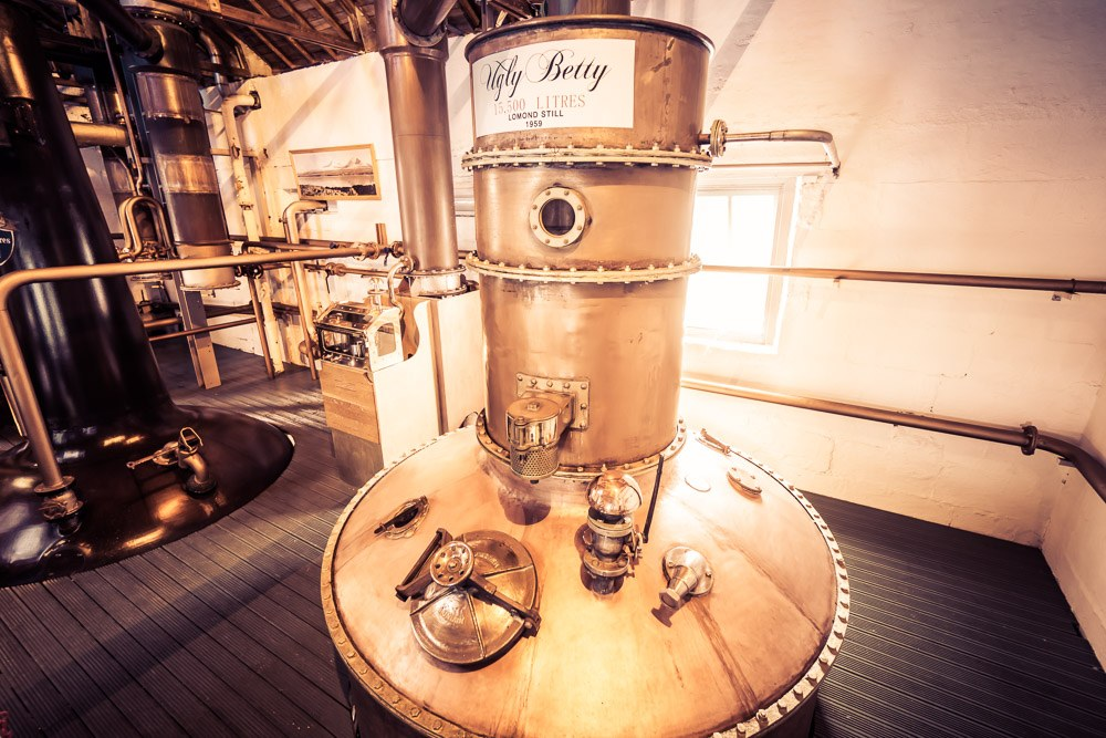 warm toned high contrast close up photo of lomond still ugly betty at bruichladdich distillery