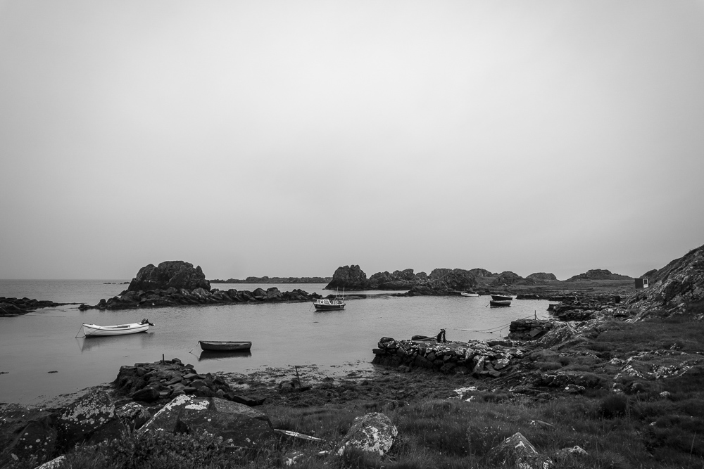 Small inlet with fishing boats near Port Ellen Islay Scotland