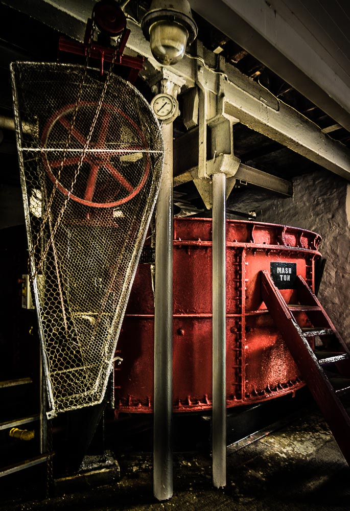 Beautiful bright red open top mash tun at Springbank Distillery