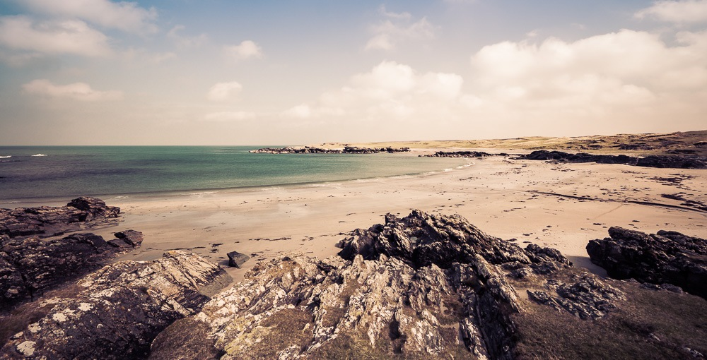 wide angle view sanaigmore bay islay turquoise water blue sky