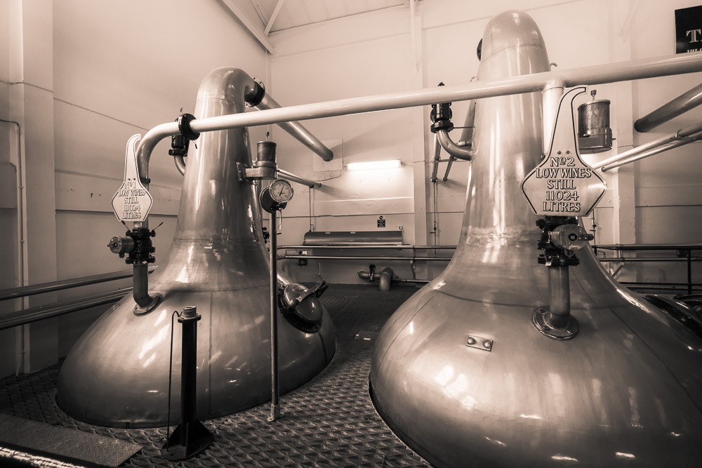 Black and white photo close up of Talisker Distillery spirit stills