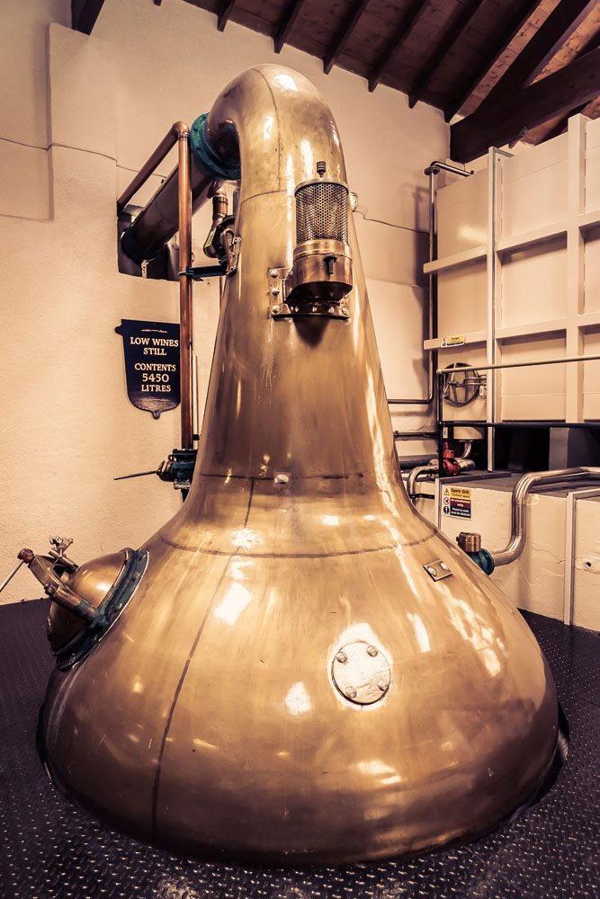 Low Wines / Spirit Still at Royal Lochnagar Distillery. Royal Lochnagar has only one pair of stills, producing around 450,000 litres per annum. The spirit still holds 5,450 litres but is generally only charged with around 4,000 litres of low wines at a time.