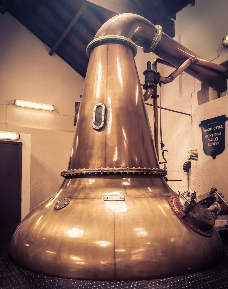 The Wash Still at Royal Lochnagar Distillery. It's capacity is 7,410 litres. The still is quite short and onion shaped, which would normally result in a heavy spirit, however, Royal Lochnagar crafts their spirit to be 'light' and grassy.
