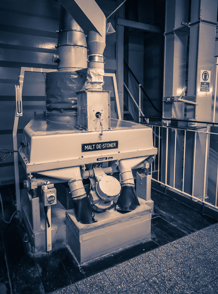 Purple toned photograph of the de-stoner at Glenfarclas distillery.