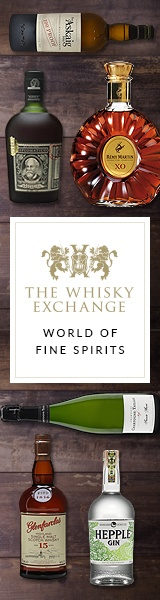 whisky exchange online store advertisement showing bottles of whisky and cognac