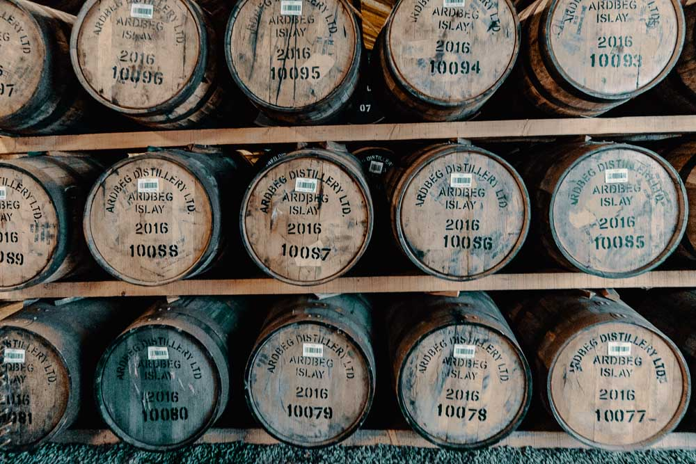 Racked casks at Ardbeg Distillery, showing 2016 casks numbers over 10,000 (Ardbeg's capacity is 10,000 casks per year, in 2016 they reached 100% capacity)