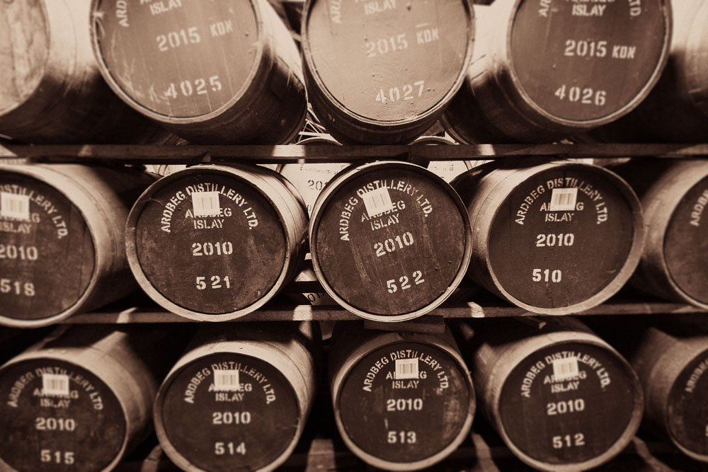 Sepia toned photograph of 2010 casks at Ardbeg distillery
