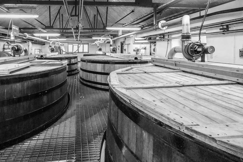 Black and white photograph of the The six washbacks at Ardbeg Distillery