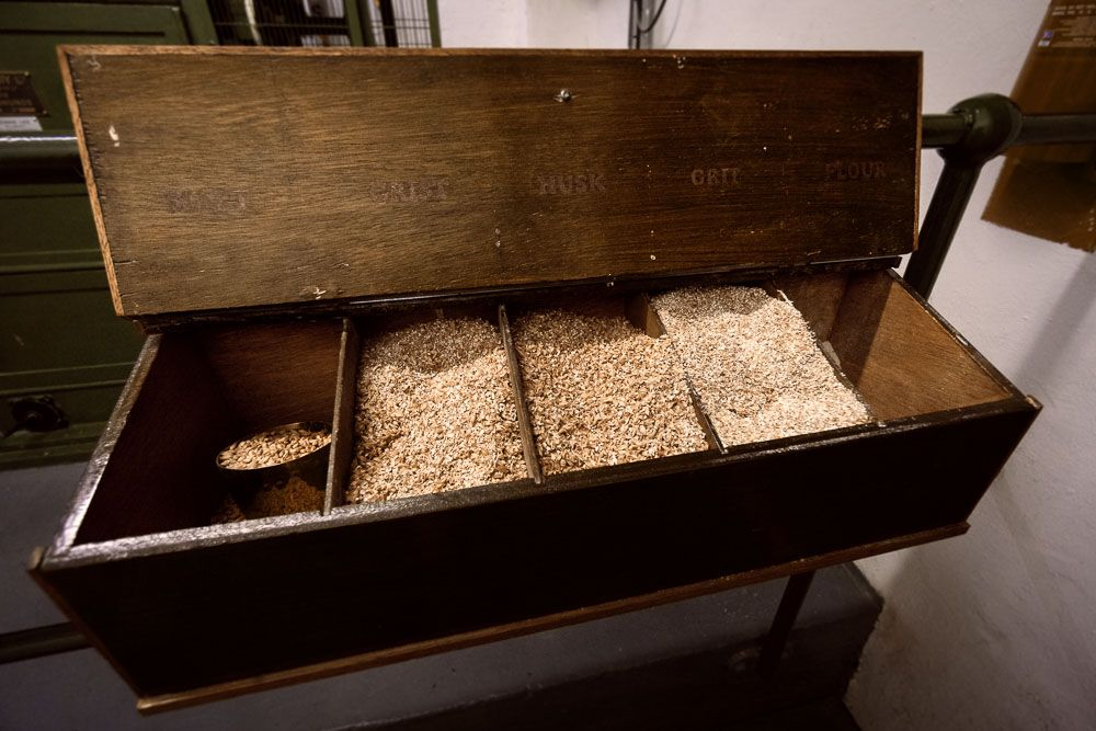 Colour photograph of malt samples including whole grains, grist and husks at Ardbeg Distillery