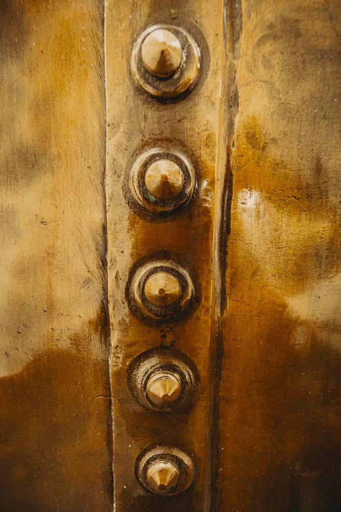 Close up of the rivets securing the copper kettles at Bowmore Distillery.