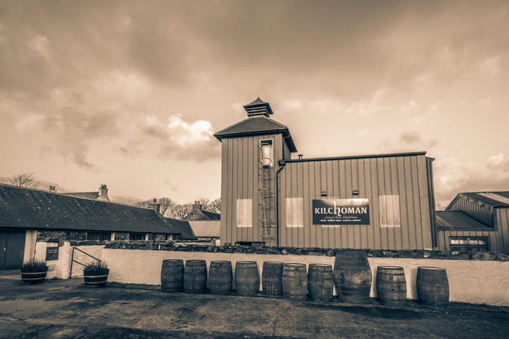 Sepia toned photograph of Kilchoman Distillery Malt House, and Kiln with Pagoda Stack.