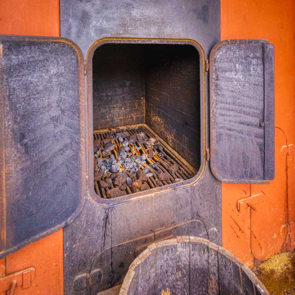 Colour photograph of the open kiln at Kilchoman Distillery