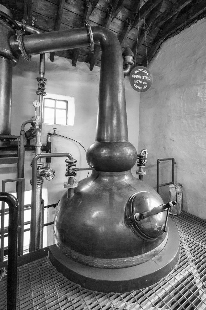 Spirit still at Kilchoman Distillery, black and white photograph