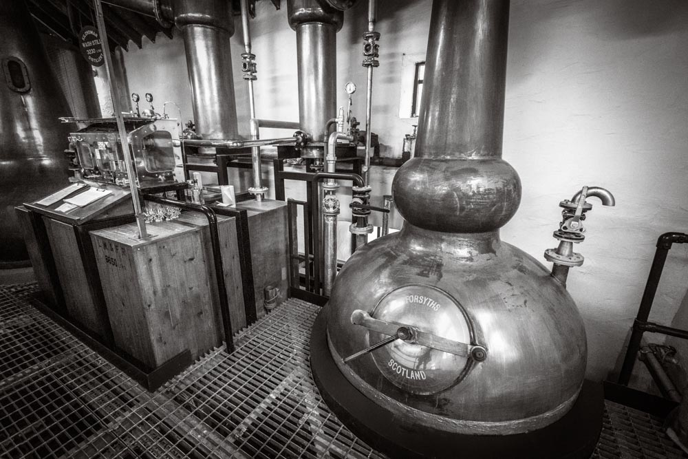 Kilchoman Distillery's spirit still and spirit safe, black and white photograph