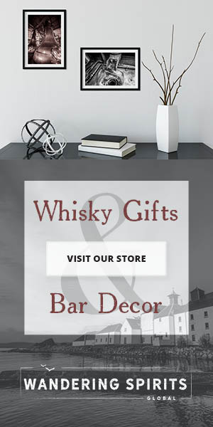 top image showing two framed distillery prints on a wall above a side table, bottom says 'whisky gifts and bar decor, visit our store, wandering spirits global